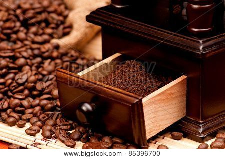 Close-up of coffee beans with coffee grinder