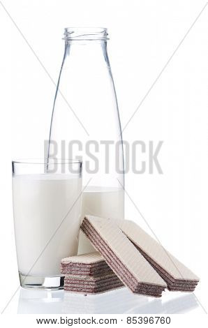 Bottle of milk with fresh wafer, isolated on white background. Studio shot.