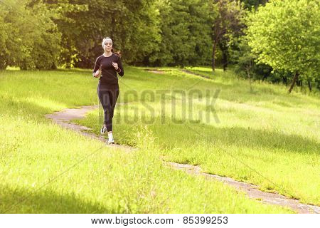 Jogging Theme: Caucasian Sportswoman Having Jogging Exercises Outdoors.