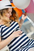 pic of wearing dress  - Cute young pregnant blonde in a white hat - JPG