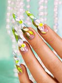 picture of nail-design  - Beautiful floral art design on female nails - JPG