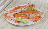 picture of cooked blue crab  - Boiled crabs with lime on the wood background - JPG