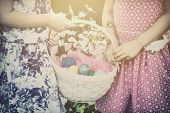 Постер, плакат: Two Girls Hands Holding An Easter Basket Retro