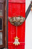 pic of coir  - Closeup decoration design Coir pots on red pole - JPG