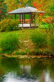 picture of gazebo  - gazebo in the empty autumn park near the pond - JPG