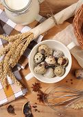 picture of chicken-wire  - Eggs and wheat on wooden table - JPG