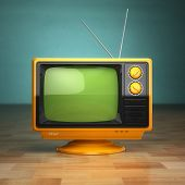 stock photo of analogy  - Retro vintage tv on green background - JPG