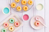 picture of ice-cake  - Iced mini bundt cakes with icing a tray and a spoon - JPG
