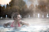 picture of washtub  - Happy young woman relaxing in thermal pool - JPG