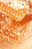 foto of honeycomb  - natural honeycombs from wax with honey honeycomb background - JPG