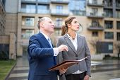 image of presenter  - Real estate agent presenting a new apartment - JPG