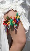 foto of garter  - Floral wedding garter on leg of bride - JPG