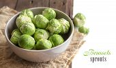pic of brussels sprouts  - Brussels sprouts in a bowl on an old wooden table - JPG