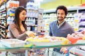 pic of grocery store  - Couple shopping at the grocery store - JPG