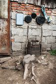 foto of junk-yard  - Pots in the nook of the yard of one Romanian village - JPG