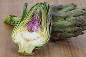 pic of artichoke hearts  - Fresh Raw artichokes on the wooden background - JPG