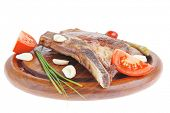 stock photo of red meat  - hot red beef meat steak on red wooden plate with capers and tomatoes isolated over white background - JPG