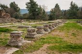 stock photo of greek  - Ancient Greek ruins at the archaeological place of Ancient Olimpia Peloponnese Greece - JPG