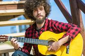 pic of afro hair  - Guitarist with plaid shirt and afro hair - JPG