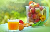 stock photo of apricot  - Juice of apricot and apricots on the table - JPG