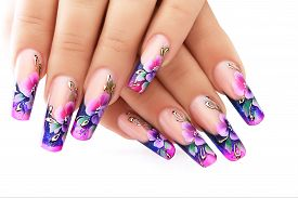 stock photo of floral design  - Female hand with floral art design nails  - JPG