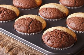 picture of chocolate muffin  - fresh chocolate muffins in baking dish from the oven closeup - JPG