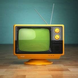 stock photo of tv sets  - Retro vintage tv on green background - JPG