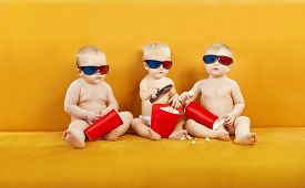 foto of 3d  - Baby 3D Glasses Watching Film On TV Children Eating Popcorn And Watch Cinema Movie In Home Theater Kids In Diapers With Remote Control - JPG