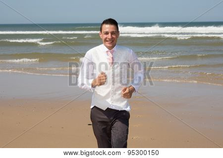 A Beautiful And Elegant Groom Runing At The Beach