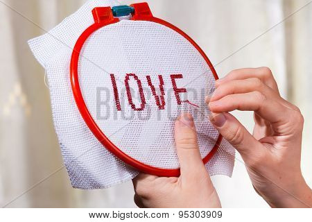 Women's Hands Embroider A Word Love