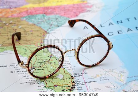 Glasses on a map of USA - Florida