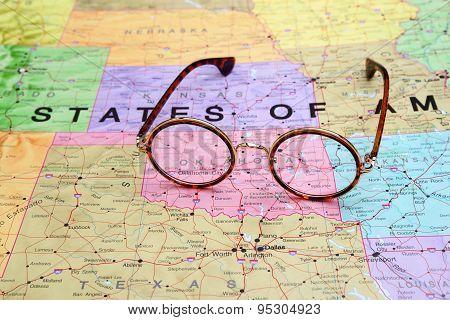 Glasses on a map of USA - Oklahoma