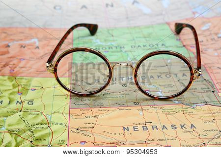 Glasses on a map of USA - South Dakota