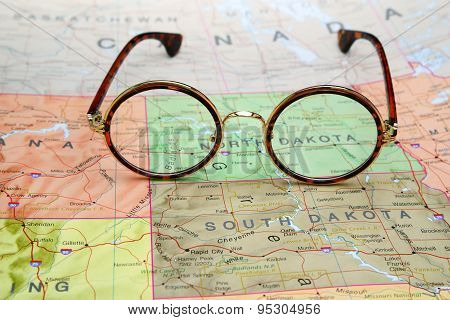 Glasses on a map of USA - North Dakota