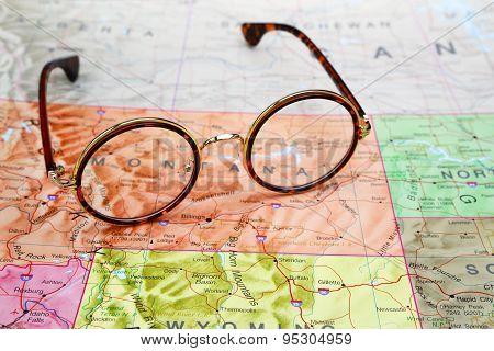 Glasses on a map of USA - Montana