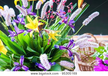 Bunch of summer flowers and wicker basket