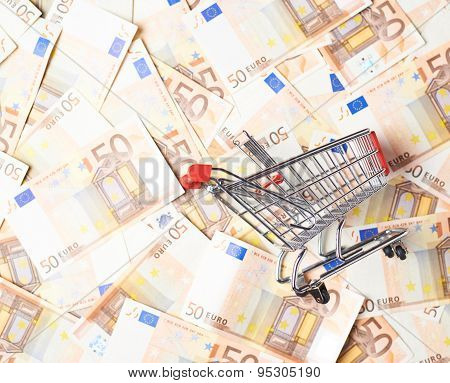 Shopping cart over the bank note bills