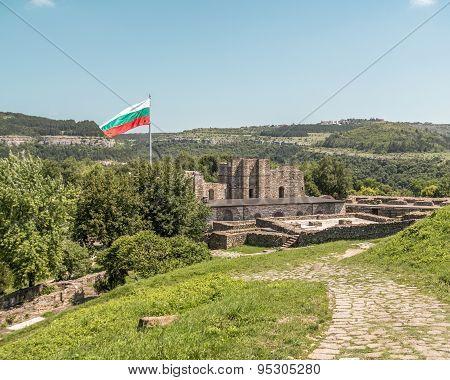 Bulgarian Flag Flying Over Ruins Of Medieval Fortress. Tsarevets, Veliko Tarnovo, Bulgaria