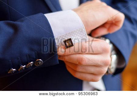 A Man Fastens A Cuff-link