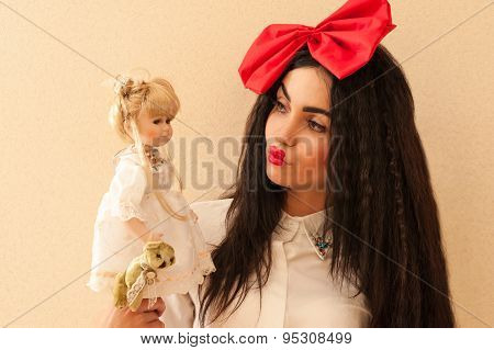 beautiful woman in the image of a doll holding a doll