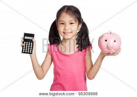 Little Asian Girl  With A Calculator And Piggy Bank