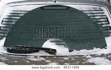 The Rear Screen Of A Car With Snow