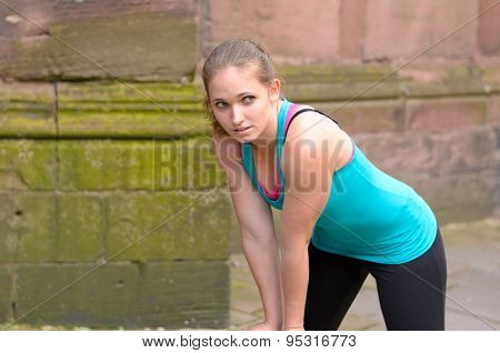 Sporty Young Woman Taking A Rest While Exercising
