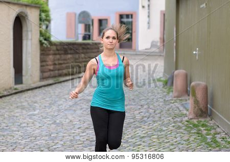 Young Woman Jogging In Town