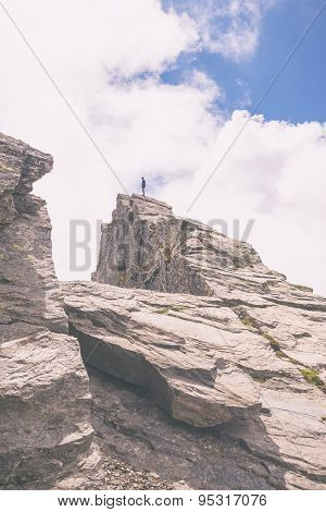 Hiker Standing On Mountain Peak, Toned Image