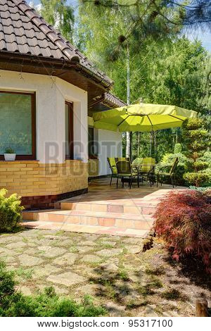 Table And Chairs Under Umbrella