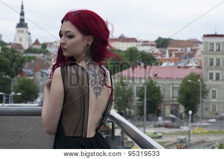 Redhead Fashion Model On Parking Balcony With City View Background