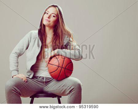 Sporty Teen Girl In Hood Holding Basketball.