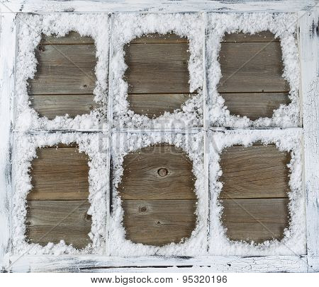 Vintage Window Covered In Powdered Snow With Rustic Wood In Background