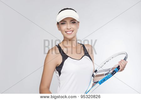 Professional Tennis Concept: Female Tennis Player Equipped In Professional Sport Gear  Holding Racke